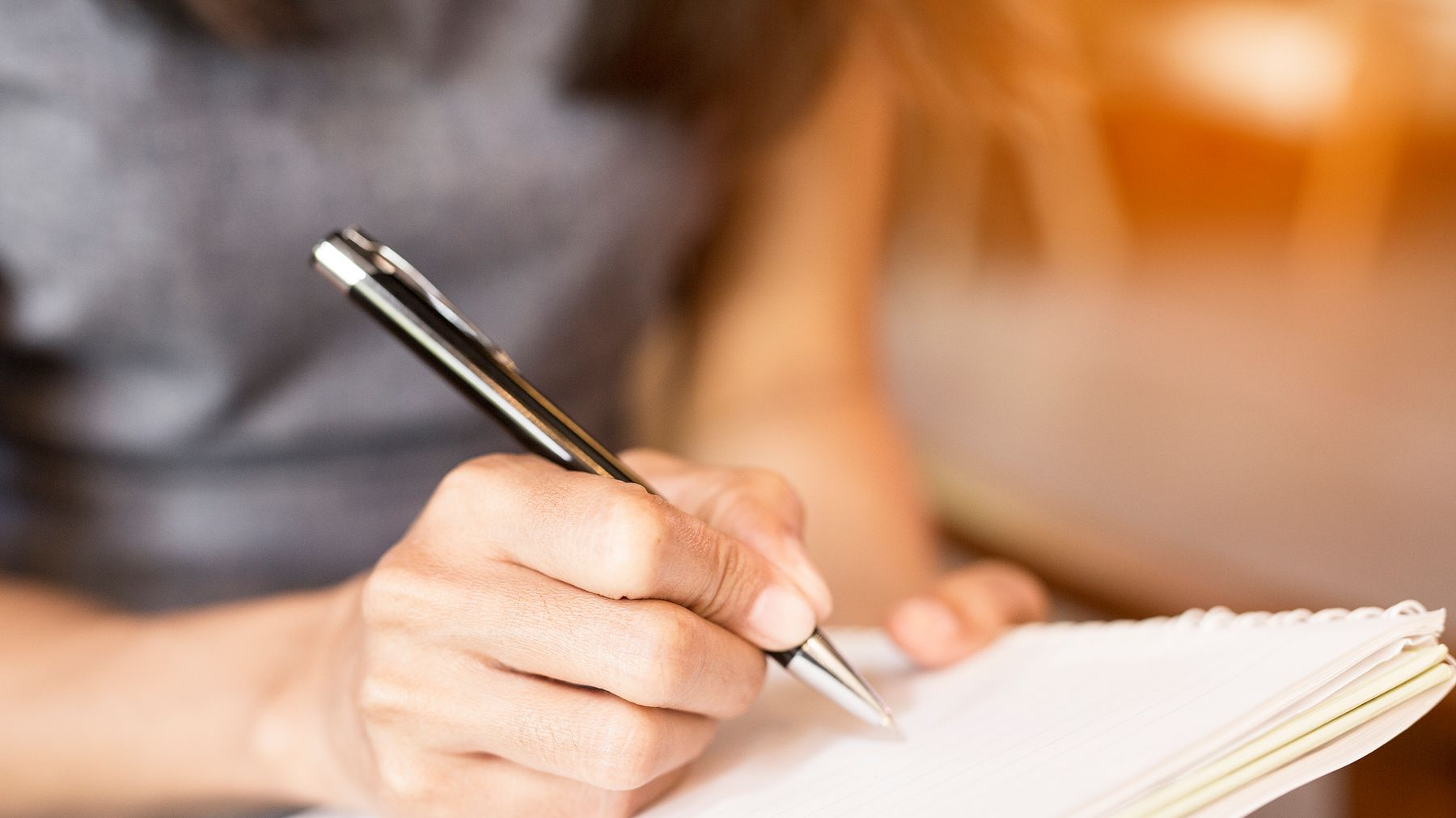 Photo of person writing for the Grazia First Chapter competition article