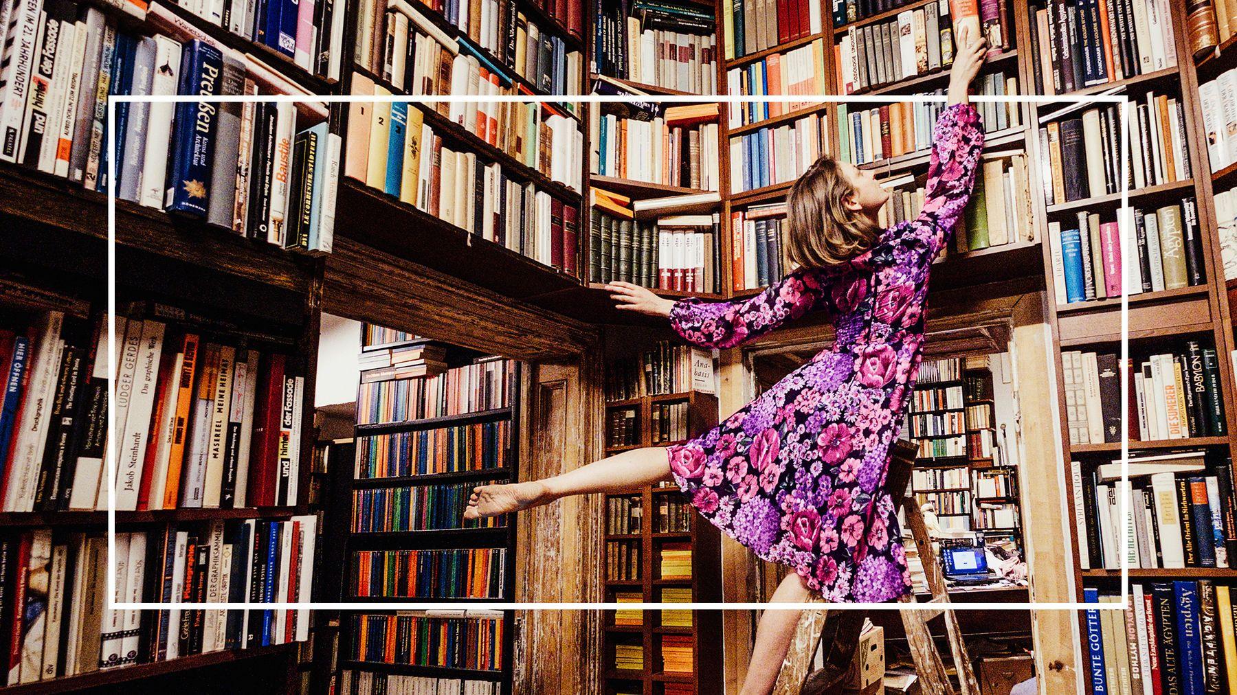 Photo of woman browsing bookshelves