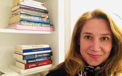 Photo of Viv Groskop and her bookshelf